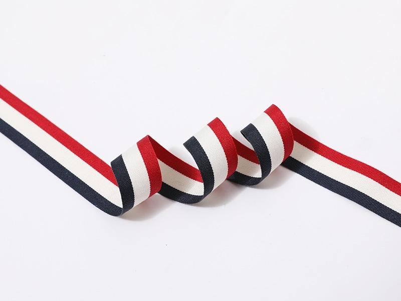 Tafet a rayas de doble cara con borde tejido en tres colores